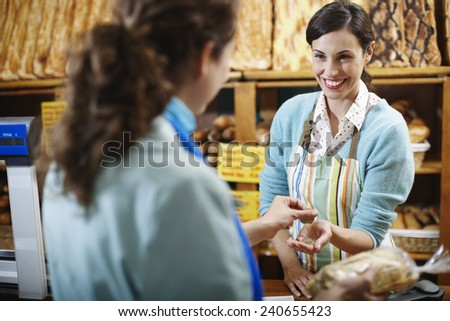 Deli Owner Serving Customer - stock photo