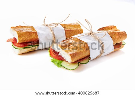deli sandwiches in paper wrap  isolated on white - stock photo