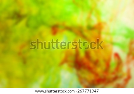 deliberately blurred; colored dye in a water as a psychedelic background - stock photo