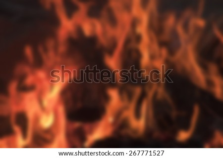 deliberately blurred image of a camp fire flames burning logs as an abstract background - stock photo