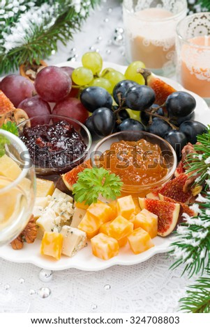 delicacy cheese and fruit plate closeup vertical, top view - stock photo