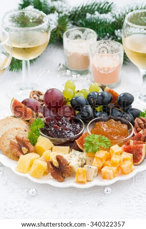 delicacy cheese and fruit plate to the holiday on table, vertical - stock photo