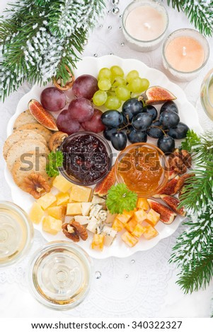 delicacy cheese and fruit plate to the holiday, vertical, top view, closeup - stock photo