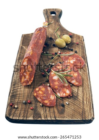 delicacy smoked sausage (salami) on a wooden board - stock photo