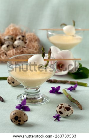 Delicate appetizer with quail eggs and steamed wild asparagus served with mustard mayonnaise. - stock photo