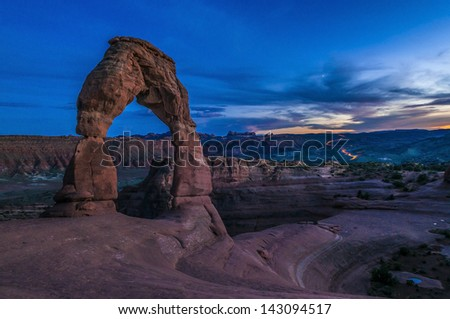 Delicate Arch against cool evening sky - Moab Utah - stock photo