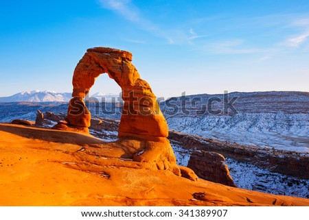 Delicate Arch on sunset in snow season, Arches National Park, Utah - stock photo