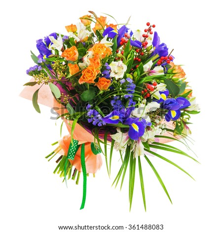 Delicate beautiful bouquet of nerine, iris, alstroemeria, roses and other flowers in orange packaging with green tape isolated on white background. - stock photo