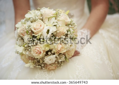 delicate bouquet bride Bride holding a beautiful composition with white and cream roses bright and original bridal bouquet gentle floral with roses - stock photo