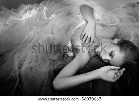 Delicate brunette posing - bw version - stock photo