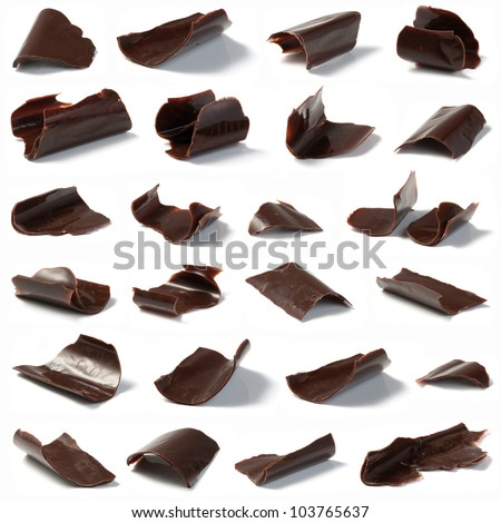 Delicate chocolate chips on a white background. Shallow depth of field. - stock photo