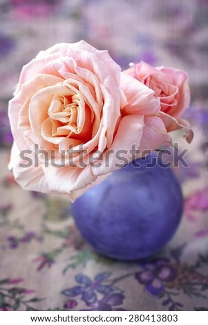 Delicate pink roses in a glass vase on the table.(vintage style)  - stock photo
