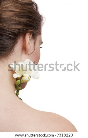 delicate skin, the back of a woman and white flower, spa treatment - stock photo
