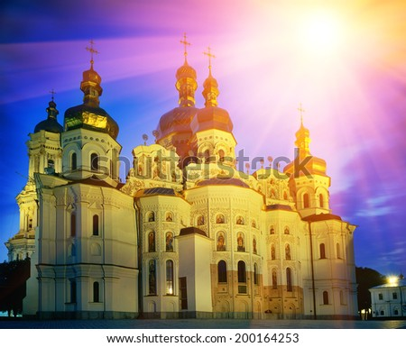 Delicate sunset paints the sky and the moon above the ancient temple of the main Christian shrines of Ukraine. Kiev-Pechersk Lavra, an Orthodox Christian monastery has a thousand-year history - stock photo