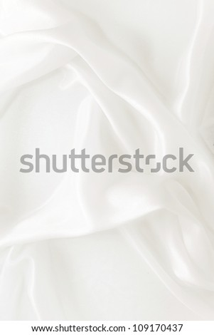 delicate waves of satin silk close up - stock photo