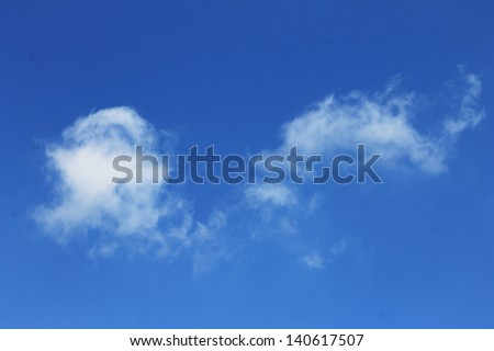 Delicate white clouds on a blue sky - stock photo