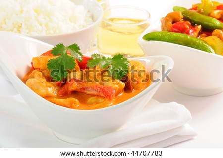 Delicious and colorful bowl of thai curry chicken. - stock photo