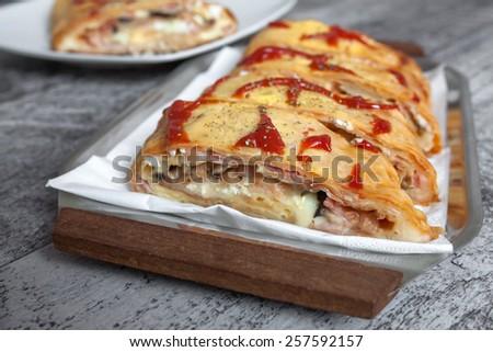 Delicious and fresh pizza sandwich  - stock photo