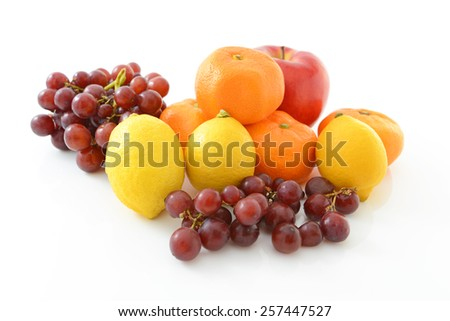 delicious and fresh variety fruits on white background - stock photo
