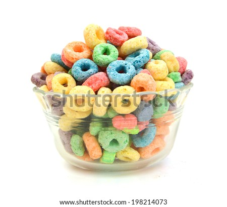 Delicious and nutritious fruit cereal loops flavorful in glass bowl in white, healthy and funny addition to kids breakfast  - stock photo