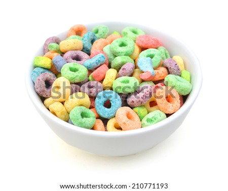 Delicious and nutritious fruit cereal loops flavorful in white bowl on white, healthy and funny addition to kids breakfast  - stock photo