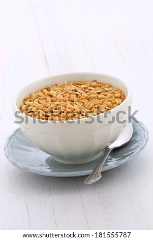 Delicious and nutritious lightly toasted breakfast muesli or granola cereal. - stock photo