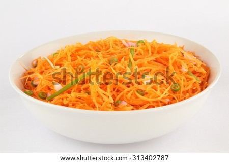 Delicious and spicy carrot spaghetti with ginger, garlic, chili and lemon. - stock photo