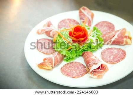 Delicious and tasty meat dishes. Parma Ham, salami. Italian appetizers.  - stock photo