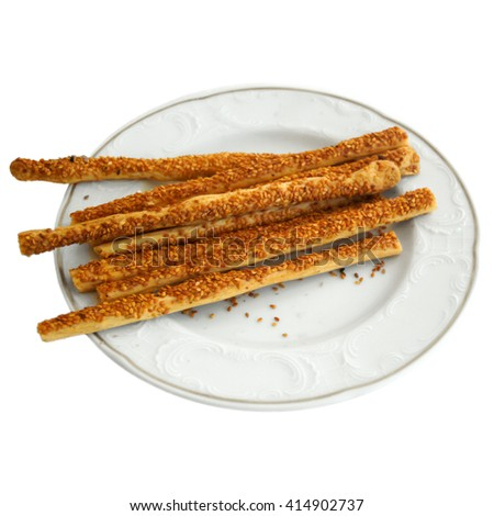 Delicious appetizer crispy sticks of puff pastry with sesame seeds - stock photo