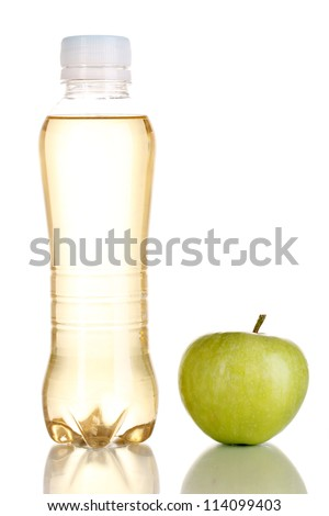 Delicious apple juice in plastic bottle and apple next to it isolated on white - stock photo