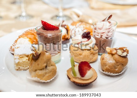delicious assorted pastries in a plate on a restaurant table - stock photo