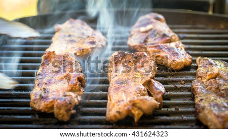 Delicious Australia Day BBQ.  Marinated boneless pieces of Australian lamb  cooked on grill - stock photo