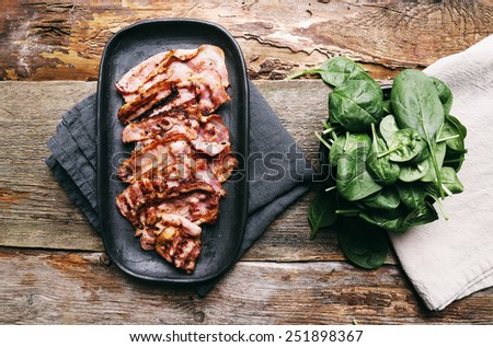 Delicious bacon on the tray - stock photo