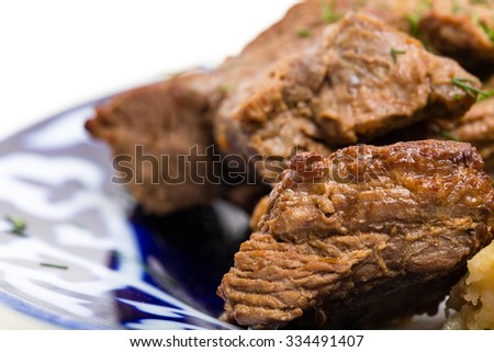 Delicious baked lamb racks with vegetable garnish and minced dill. Macro. Photo can be used as a whole background. - stock photo