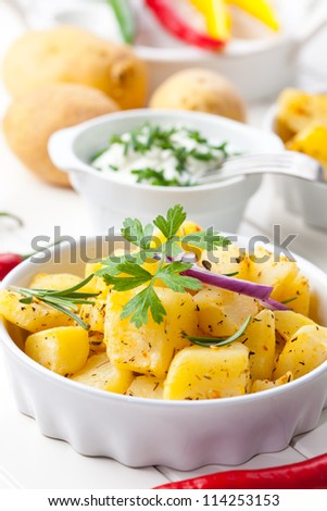Delicious baked potatoes with sour cream - stock photo