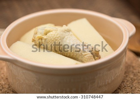 Delicious bamboo sprout or shoot with chicken drum stick in ceramic bowl for Chinese food background - stock photo