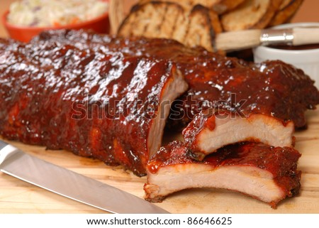Delicious BBQ ribs with toasted bread, cole slaw and a tangy BBQ sauce - stock photo