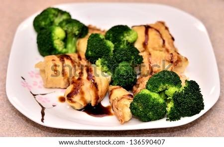Delicious bean curd with broccoli dish portrait - stock photo