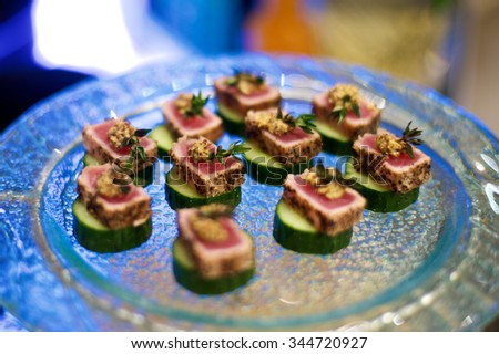 Delicious Beef Canap���©s on plate in restaurant - stock photo