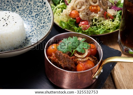 Delicious Beef stew set dish on wooden table - stock photo