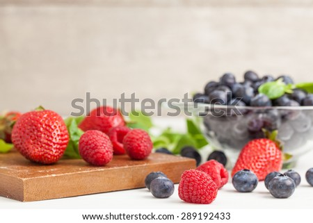 Delicious berries. Strawberries, blueberries and raspberries. Healthy summer fruits, antioxidants - stock photo