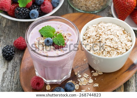 delicious berry smoothies with oatmeal, top view, horizontal - stock photo