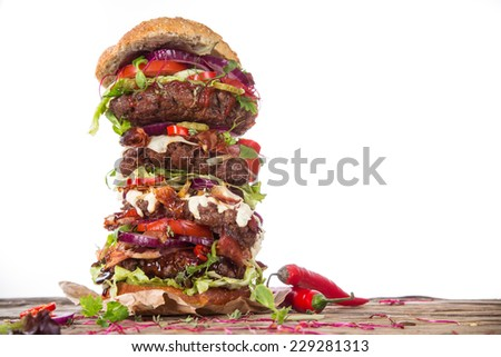 Delicious big hamburger on wooden background - stock photo