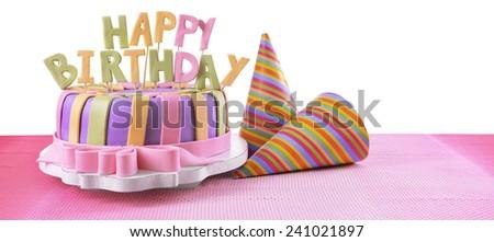 Delicious birthday cake on table on white background - stock photo