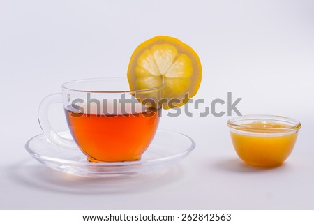 Delicious black tea with lemon and honey. - stock photo