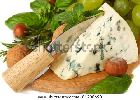 Delicious blue cheese with knife, nuts and spices herbs. - stock photo