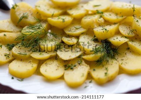 Delicious boiled potatoes with dill and olive - stock photo