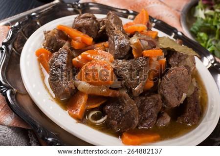 Delicious bourguignon beef stew on white plate. Selective focus - stock photo