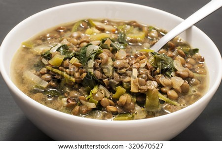 Delicious bowl with lentils and spinach. - stock photo