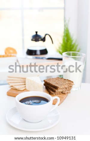 Delicious breakfast / Black coffee, cheese, wholemeal bread, milk - stock photo